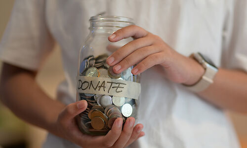 Donation jar full of money
