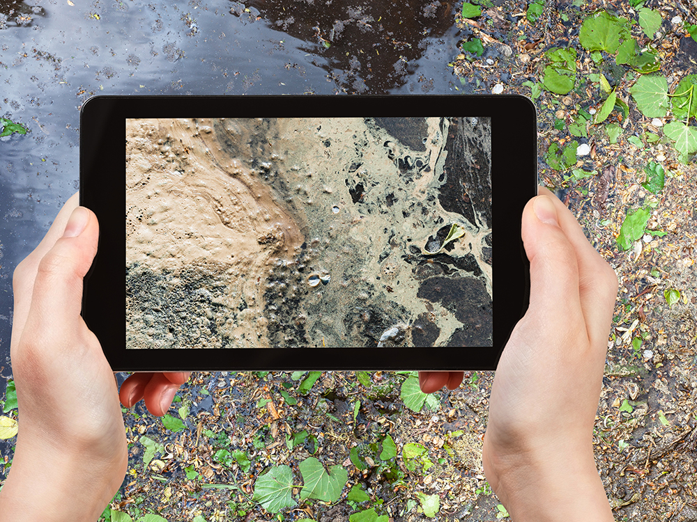 Taking a picture of pollution with tablet